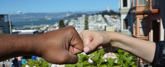Black fist and White fist touching, uniting in solidarity
